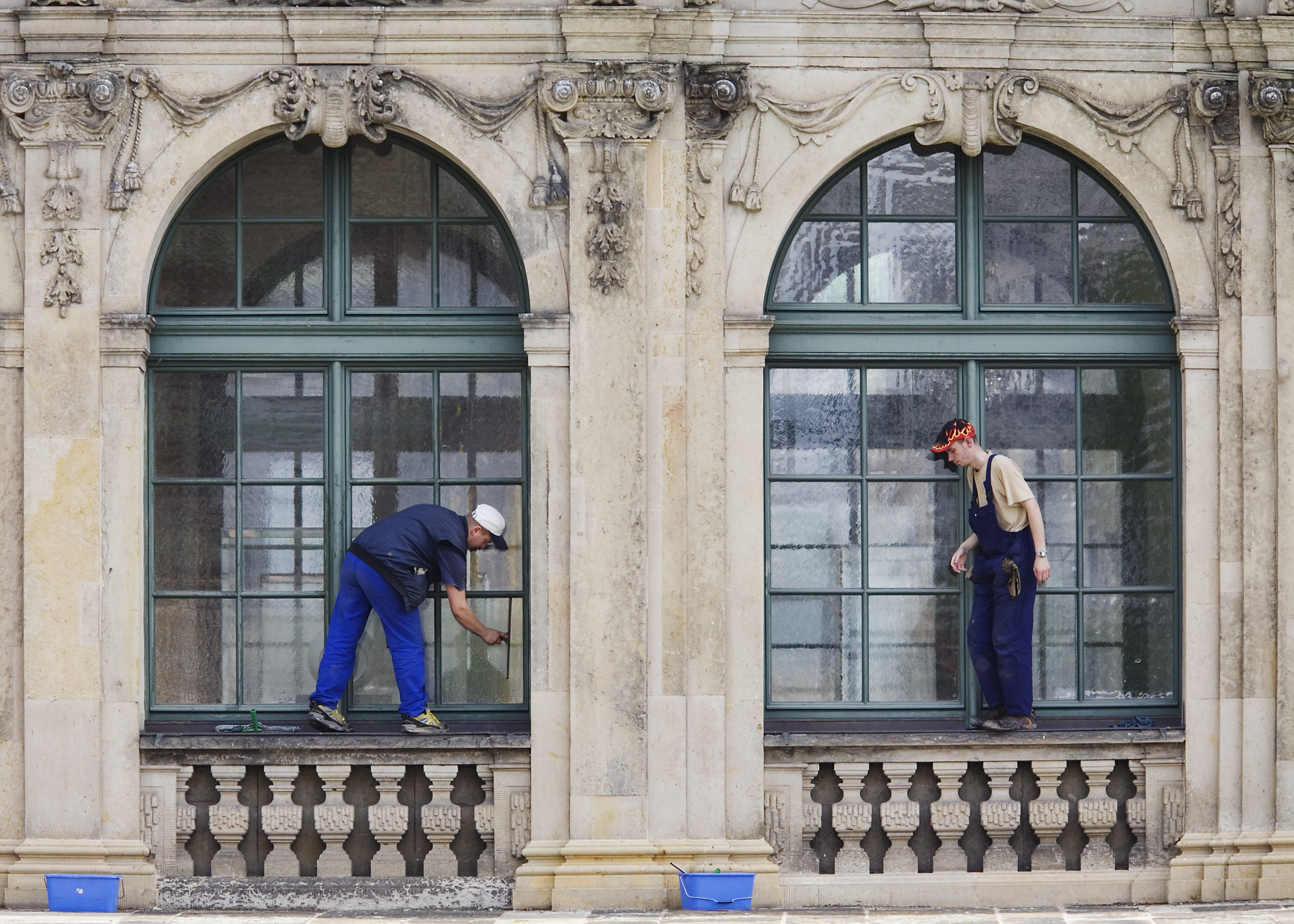 window cleaner window windows architecture detail sculpture arch archway archways arches occupation trade employment clean cleaning maintenance maintain janitorial housekeeping architecture duo window cleaner window cleaners cleaning symmetry symmetric sy